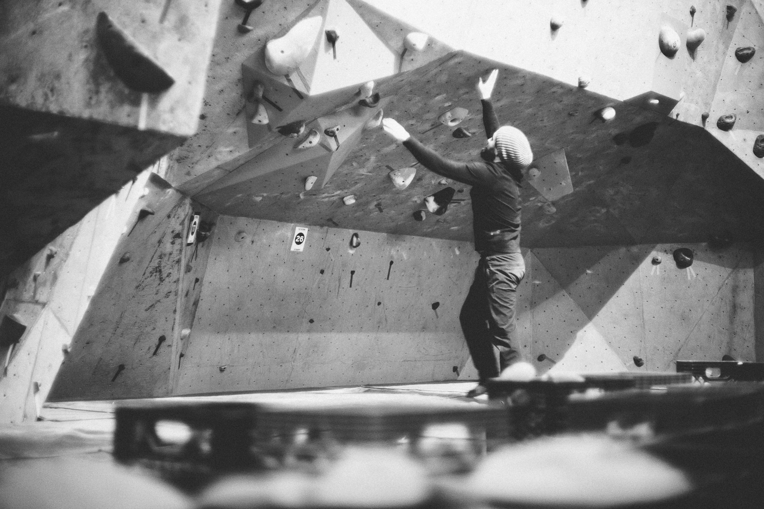 Climber setting a bouldering route at Coyote Rock Gym Intro to Setting Clinic
